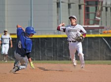 Naugatuck's Corey Plasky (5) turns a double play as Fairfield Ludlowe's Michael Bernstein (6) slides into second base April 21 in Naugatuck. –ELIO GUGLIOTTI