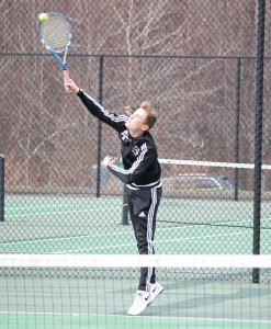 Naugatuck's Jonas Mauermann serves during his match versus Woodland's Mike Roulanaitis April 8 in Beacon Falls. –ELIO GUGLIOTTI