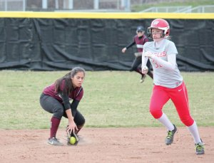 Naugatuck's Jenna Massicotte fields a ground ball at shortstop as Wolcott's Lyndsy Ignacio (36) runs to third Monday in Naugatuck. Naugatuck won the game, 7-6, on a walk-off single by Massicotte. –ELIO GUGLIOTTI