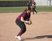 Naugatuck's Taya Diaz goes to first after fielding a ground ball at third base versus Holy Cross Monday in Naugatuck. Holy Cross won the game, 3-0. –ELIO GUGLIOTTI
