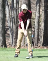 Naugatuck's Cody Butler lines up his tee shot on the first hole at Hop Brook Golf Course in Naugatuck Monday versus O'Brien Tech. –ELIO GUGLIOTTI