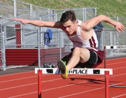 Naugatuck's Matt Wahl leaps over a hurdle on April 12 during a quad-meet against Waterbury Career, Torrington and Wilby in Naugatuck. Through two meets, the Naugatuck boys and girls teams are 5-1. –LUKE MARSHALL