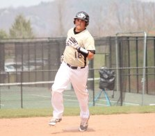 Woodland's Jared Grillo rounds second base after hitting a three-run home run April 22 versus Ansonia in Beacon Falls. –ELIO GUGLIOTTI