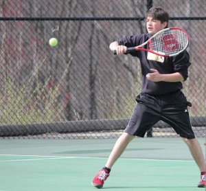 Woodland's Nick Lucas hits a backhand during his match with Naugatuck's Marco Rebelo April 8 in Beacon Falls. –ELIO GUGLIOTTI