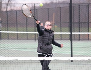 Woodland's Ali Mayne returns a shot during her match versus St. Paul's Natasha Kempes April 6 in Beacon Falls. The Hawks defeated St. Paul, 5-2. –ELIO GUGLIOTTI