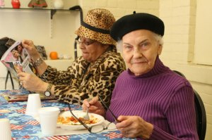 From left, Vickie Rodriguez and Helen DiStasio enjoy lunch at the Naugatuck Senior Center April 7. -REPUBLICAN-AMERICAN