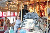 Jazmine Wright, 3, of Naugatuck rides the carousel with her father, Darrius Wright, during the Coleman Brothers Carnival May 19 in Naugatuck. The carnival was sponsored by the Naugatuck Education Foundation, a nonprofit organization that provides grants for education programs in borough schools that aren't funded through the annual school budget. A portion of the proceeds from the carnival went to the NEF. –ELIO GUGLIOTTI