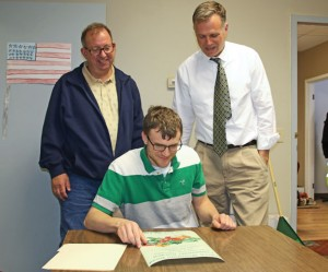 From left, Naugatuck Geographic Information System Coordinator Fred Agee, Alex Olbrys, and Public Works Director James Stewart look over a flyer for the proposed community garden May 6 at the Public Works office. The borough has begun accepting application for garden plots. –LUKE MARSHALL