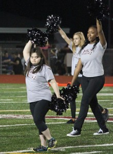 Naugatuck High School sophomore Alana Alves, front, and fellow members of the dance team perform during halftime of a football game last season. –FILE PHOTO