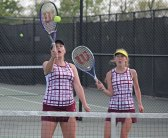 Naugatuck's Ally Mezzo hits the ball as her doubles partner, Kelly Murphy, watches versus Watertown's Maddie Cacciato and Julia D'Occhio May 20 during the Naugatuck Valley League tennis tournament final in Beacon Falls. Naugatuck won the match, 4-3. –ELIO GUGLIOTTI