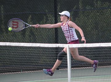 Naugatuck's Lori Dietz tracks down the ball during a doubles match with her partner, Patricia Escaleira, versus Watertown's Christina Barkow and Alyssa Clifford May 20 during the Naugatuck Valley League tennis tournament final in Beacon Falls. Naugatuck won the match, 4-3. –ELIO GUGLIOTTI