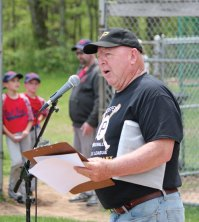 Prospect Little League President Larry Fitzgerald speaks during the league's opening day ceremony May 14 in Prospect. The Little League is celebrating its 50th anniversary this year. –ELIO GUGLIOTTI