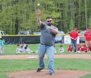 Prospect Recreation Director Christopher Moffo throws out the first pitch during the Prospect Little League's opening day ceremony May 14 in Prospect. The Little League is celebrating its 50th anniversary this year. –ELIO GUGLIOTTI