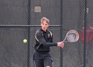 Woodland's Josh Powanda lines up a shot versus Wolcott April 29 in Beacon Falls. Wolcott won the match, 8-1. –ELIO GUGLIOTTI