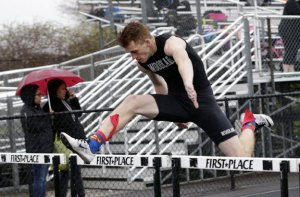 Woodland's Brandon Clifford clears a hurdle during the 110 hurdles during a meet with Seymour, Kennedy and Waterbury Career Academy in Beacon Falls on Tuesday. -REPUBLICAN-AMERICAN