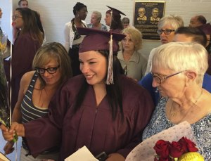 Bailey Messenger, center, celebrates with family members following her graduation from Naugatuck Adult Education Thursday night. With her are her mother, Courtney Messenger, left, and her great grandmother, Hellen Rotunda. -REPUBLICAN-AMERICAN