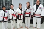 David Marimekala, Sean Sayer, Michelle Bernadini, Gina Greco and Martin Longo from USA Martial Arts in Naugatuck were promoted to 1st Dan Black Belt in Cheezic Tang Soo Do Karate May 6 at a grading at the Wolcott Youth Center. –CONTRIBUTED