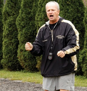 Woodland cross country and girls track coach Jeff Lownds is pictured in 2011 cheering on the cross country team during a meet. Lownds was recently named Boys Cross Country Coach of the Year by the Connecticut High School Coaches Association. -REPUBLICAN-AMERICAN ARCHIVE