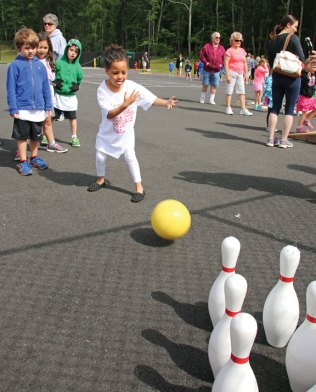 Prospect Elementary kindergartner Siobhan Moore looks to knock down some pins while bowling during Field Day at Prospect Elementary School June 9. –LUKE MARSHALL