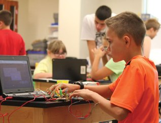 Julian Fauteux, a rising seventh-grader from Prospect, wires a video game controller during the Region 16 STEM Summer Camp July 15 at Prospect Elementary School. The week-long camp was run by the CT STEM Academy and featured hands-on activities in the fields of science, technology, engineering and mathematics, including coding with Ozobots. –ELIO GUGLIOTTI