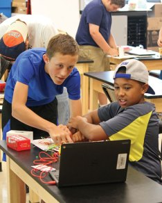 Nathaniel Smith, left, a rising eighth-grader from Beacon Falls, and Joshua Gibson, a rising seventh-grader from Prospect, play a video game with a controller they wired during the Region 16 STEM Summer Camp July 15 at Prospect Elementary School. The week-long camp was run by the CT STEM Academy and featured hands-on activities in the fields of science, technology, engineering and mathematics, including coding with Ozobots. –ELIO GUGLIOTTI
