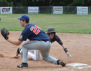 Post 17's Jarrett Allen dives back to first base against Ansonia Saturday at Rotary Field in Naugatuck. Post 17 won, 3-0. –KEN MORSE