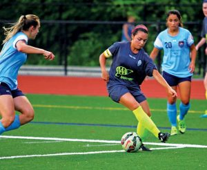 Former Naugatuck High School soccer player Stephanie Santos is in her second season with the New England Mutiny of the United Women's Soccer League. Among her teammates is former Woodland soccer player Kieran DeBiase. –GEORGE SKOVERA