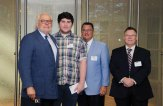 Jared Main, of Naugatuck, recently received a $1,000 scholarship from the BIC Corporation in Shelton during the company's 46th Annual Scholarship Awards Ceremony. The scholarships are awarded annually to children of BIC employees and are based on the students' scholastic achievements, community service and essay response. Main is studying biology at Southern Connecticut State University. Pictured, from left, BIC Chairman and CEO Bruno Bich, Main, President of BIC North America Consumer Products Chris Mills, and Vice President Human Resources BIC North America Consumer Products & Graphic David Brown. –CONTRIBUTED