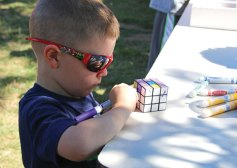 Dominic Sciarretto, 4, of Prospect, colors a Rubik's Cube Aug. 23 during Prospect's annual End of Summer Fun Week on the Town Green. –LUKE MARSHALL