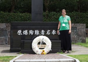 Long River Middle School teacher Marina Outwater stands in front of a memorial in Nagasaki, Japan that marks the epicenter of where America dropped an atomic bomb in 1945 during World War II. –CONTRIBUTED