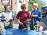 Boy Scouts, from left, Lucas Patino, Robbie Fanzutti and Nate Gairing from Troop 102 demonstrate how to tie knots during the Harvest Moon Festival on the Naugatuck Green last year. –FILE PHOTO