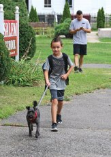 The new school year started Aug. 25 in Naugatuck and Region 16. Salem Elementary School third-grader Dantae Yannantuono, 8, walks his dog, Pedro, to school with him on the first day of school in Naugatuck. –LUKE MARSHALL