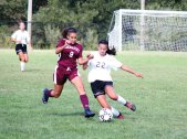 Naugatuck's Sofia Marques (9) and Woodland's Julia Accetura (22) battle for the ball Sept. 16 in Beacon Falls. Woodland won the game, 5-0. –ELIO GUGLIOTTI