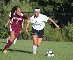 Naugatuck's Alyana Sosa (7) and Woodland's Juliana Villano (6) battle for the ball Sept. 16 in Beacon Falls. Woodland won the game, 5-0. –ELIO GUGLIOTTI