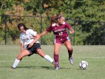Naugatuck's Mia Rotatori (12) fends off Woodland's Julia Accetura (22) Sept. 16 in Beacon Falls. Woodland won the game, 5-0. –ELIO GUGLIOTTI