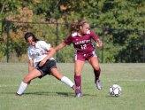 Naugatuck's Mia Rotatori (12) fends off Woodland's Julia Accetura (22) Sept. 16 in Beacon Falls. Woodland won the game, 5-0. –ELIO GUGLIOTTI