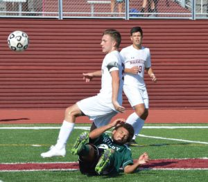 Naugatuck's Devon Curtis takes down a Wilby attacker Sept. 9 in Naugatuck. Naugatuck won the game, 7-0. –KEN MORSE