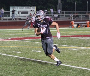 Naugatuck's Hubert Lutzykowski returns an interception for a touchdown Sept. 9 versus Derby in Naugatuck. Naugatuck won the game, 44-21.  –ELIO GUGLIOTTI