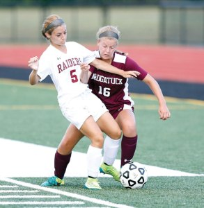 Torrington's Kristina Michaud, left, and Naugatuck's Nicole Crowley battle for the ball Sept. 9 in Torrington. Naugatuck won the game, 4-2. -REPUBLICAN-AMERICAN