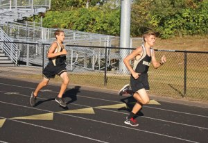 Woodland's Matthew Luxeder, right, and Vincent Costanzo lead the pack early on during a meet Tuesday versus Crosby, Torrington and Wolcott in Beacon Falls. –LUKE MARSHALL