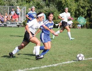 Woodland's Gillian Hotchkiss (16) pushes the ball up the field past Seymour's Mia Accavallo (9) Sept. 9 in Beacon Falls. Woodland won the game, 7-0. –ELIO GUGLIOTTI
