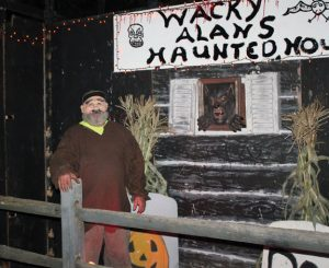 Alan Musbeck, wearing a Halloween mask, stands outside Wacky Alan's Haunted House at his home at 156 Quinn St. in Naugatuck. The haunted house, which Musbeck built, is open on Halloween from 6 to 9 p.m. –ELIO GUGLIOTTI