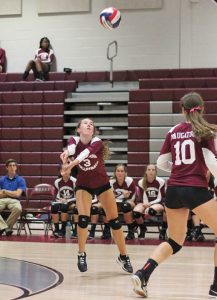 Naugatuck's Kelly Murphy bumps the ball Oct. 6 versus Seymour in Naugatuck. Seymour won the match, 3-0. –ELIO GUGLIOTTI