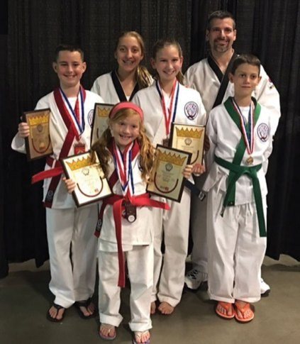 Prospect Martial Arts students Hunter Morgan, Ashlyn Manual, Payton Lowden, Julia Lowden, Nicholas Sciarretto and owner/instructor Eric Levesque traveled to the 2016 WTSDA World Tang Soo Do Championships in held in Greensboro, N.C. this summer. Prospect Martial Arts captured one silver and five bronze medals in forms, weapons and sparring. –CONTRIBUTED