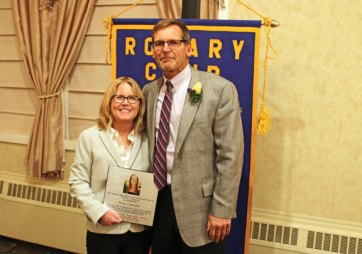 Paul and Lisa (Barry) Fitzpatrick hold a plaque honoring Theresa's Battleship, an organization named after their late daughter, Theresa, during the annual Paul Harris Dinner Nov. 16 at The Crystal Room in Naugatuck. The Naugatuck Rotary Club honored the Fitzpatricks with the Paul Harris Award for their work with Theresa's Battleship, which they founded. The foundation raises money for children's cancer research. The Paul Harris Award is named for the original founder of the Rotary Club. –LUKE MARSHALL