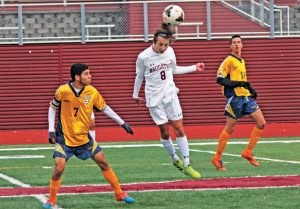 Naugatuck's Jake Corbo (8) heads the ball in front of Kennedy's Rafael Carneiro (7) Saturday during a quarterfinal match of the NVL tournament at Naugatuck High. Naugatuck won, 4-0, and defeated Ansonia, 2-0, Tuesday in the semifinals. –ELIO GUGLIOTTI