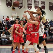 Naugatuck's Alexis Woods fights for a rebound with Wolcott's Megan Doubleday (24) Tuesday at Naugatuck High School. Wolcott won the game, 35-26. –ELIO GUGLIOTTI