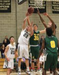 Woodland's Dylan Sender (22) puts a shot up as Holy Cross' Jack Greene (33) defends Monday night in Beacon Falls. Holy Cross won the game, 80-59. –ELIO GUGLIOTTI