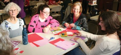Naugatuck residents, from left, Joy MacDonald, Londyn Burger, Carolyn Burge, and Lauren Burger work on valentines during the Trumbull-Porter Chapter Daughters of the American Revolution's tenth annual Valentines for Veterans Workshop at Grace Lutheran Church in Naugatuck Jan. 21. In total, 162 valentines and 195 individual bags of assorted candies were made for veterans at the Newington, Rocky Hill and West Haven veterans hospitals. –CONTRIBUTED