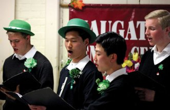 Members of the Legionaries of Christ from Legion of Christ College in Cheshire sing an Irish ballad at the Naugatuck Senior Center during a St. Patrick's Day lunch March 17. –ELIO GUGLIOTTI